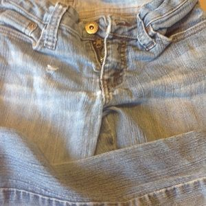 Distressed jeans by Dollhouse size 5